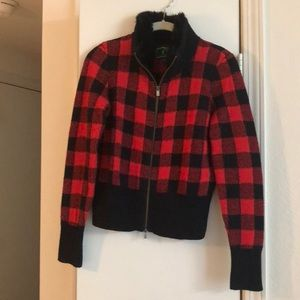 Red and black jacket/sweater with fur collar.